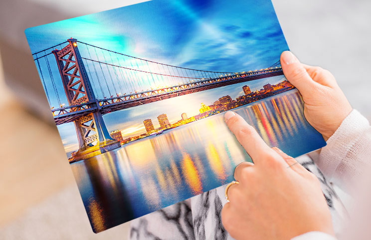 A lifestyle shot of a metal print with a bridge on it